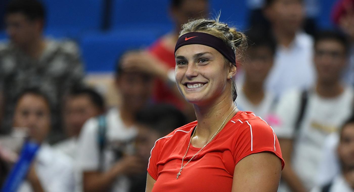 Aryna Sabalenka smiles after beating Ashleigh Barty 6-4, 6-4 (Getty)