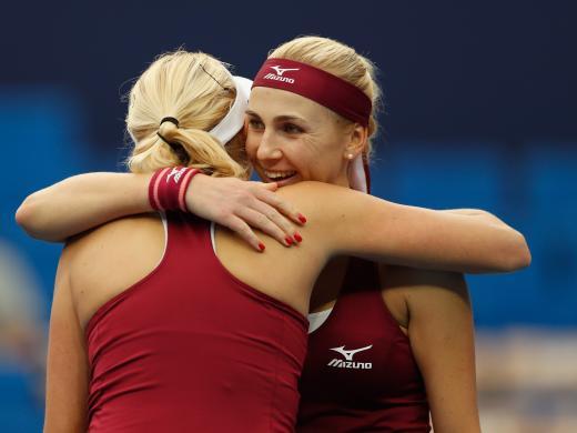 Lyudmyla and Nadiia Kichenok hug after a tricky three-set win over Yang Zhaoxuan and Xinyu Jiang (Getty)