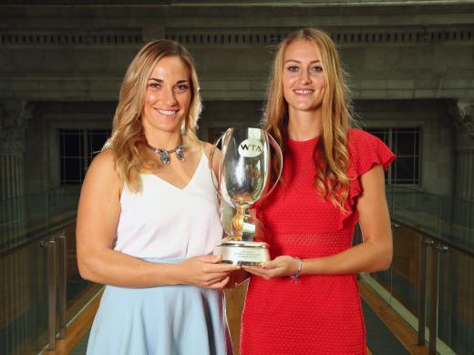 Timea Babos and Kristina Mladenovic with the Martina Navratilova Trophy (Getty)